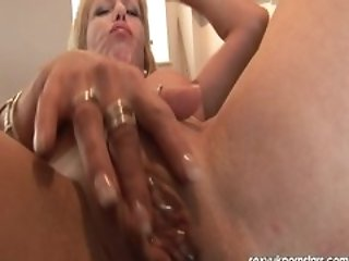 British granny plays with her pierced pussy