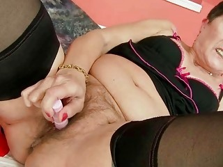 Fat grandma in black stockings gets fucked hard