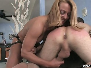 Horny blond mom button fucks her fellow with big strapon hard