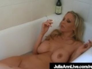 """Busty light-haired cougar Julia Ann Smokes Her Cigs soddening In bathtub!"""