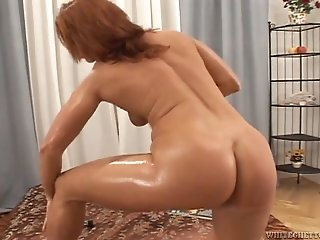 Slutty red haired chick and dirty brunette wench blow staff cock