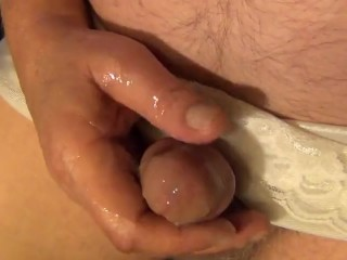 Tugging off and jizzing close up