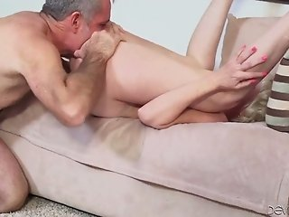 Horny granny with heavy makeup is on her knees with a dick in her mouth