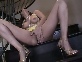 Boobalicious brunette babe Sunny Leone masturbates her pussy on the steps