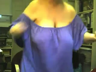 Playful and cheerlful granny shows off her big boobs