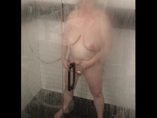 Cougar with good-sized baps masturbating in the douche - Trailer