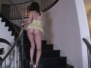 Sexy babe Sunny Leone is fingering herself vigorously right on the stairs