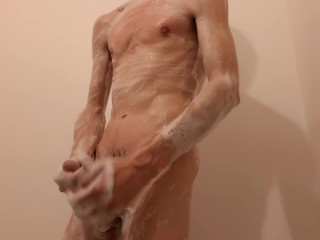 Skinny guy masturbating off coated in foam with a lil' bit of post jism
