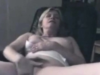 Mature May fondles her fur covered muff at home
