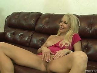 Provocative blonde mistress masturbates her muff and gives blowjob