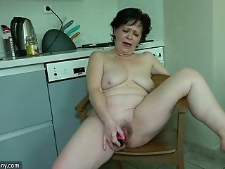 This perverted mature woman is in the mood for masturbating