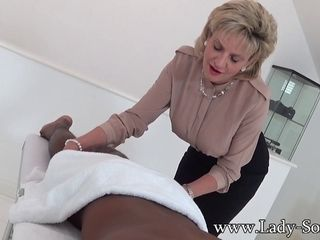 Lady Sonia giving a massage and blow-job to a bbc