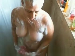 Fap off on buxomy mature gal while she showers
