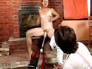 Redhead granny fucked by the machine