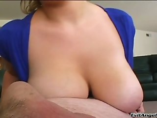 Mouth watering huge breasted blondie is busy with sucking nice titjob