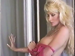 Whorish blond mommy shows off her sweet big boobies on camera
