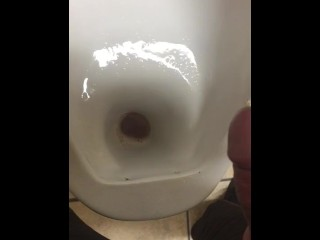 Dude with stiff pecker compels piss out while at work