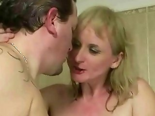 Two guys fucking and pissing on busty grandma