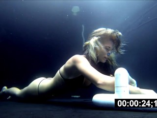 Uber-sexy woman breath holding underwater constractions