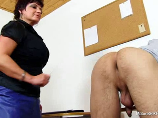 Mature educator gives her schoolgirl a hand-job