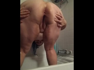 Obese cougar stretching booty in the bathroom