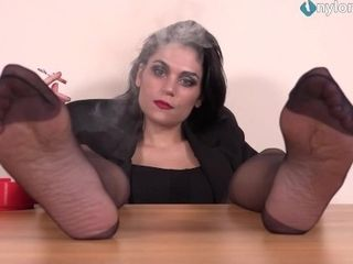 'Smokes a cig while her nylon soles are up'