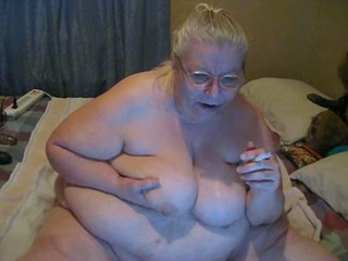 Webcam solo with nude obese granny smoking a cigarette