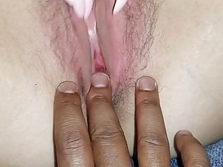 The domme toying with her mouth-watering moist labia all