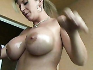 Mega busty hottie in red sexy top Sara swallows giant black cock