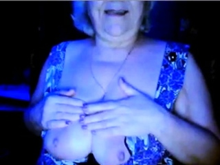 Steamy grandmother showcasing her good-sized titties of her spouse covert