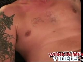 Inked mature man jacks off his rock-hard meat and pops fountains