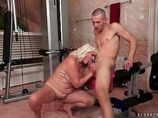 Naughty granny gets fucked by young man in the gym