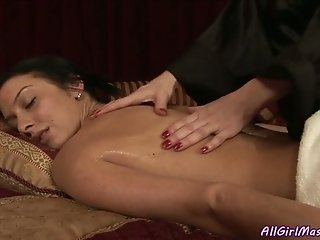 Mega busty brunette mom tickles shaved kitty of her naughty chick in massage parlor